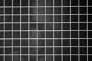 black tile wall background
