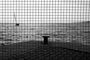 Sea view over the net with a mesh