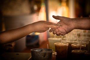 Hands exchanging money at market