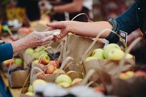 Sale: Hands exchanging money