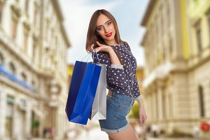 model holding her shopping bags
