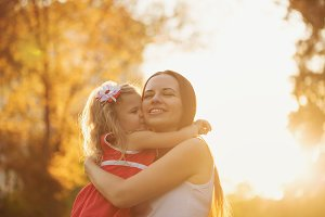 Daughter hugging mother