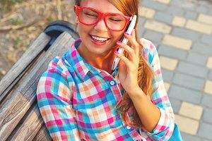 Girl hold notebook, talk on phone