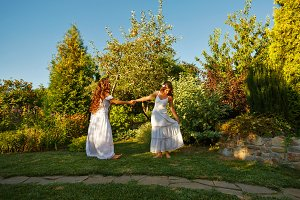 Two sisters whirling.