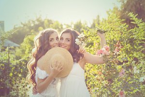 Two sisters embracing in garden