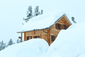 wood house in winter mountain