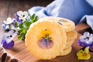 Homemade shortbread cookies with edible flowers