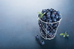 Freshly picked blueberries in metallic cup