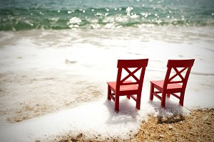 Two Empty Chairs On Sea Shore
