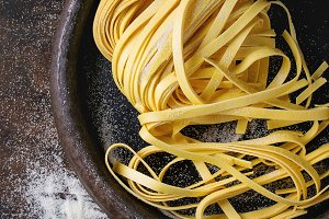 Raw homemade pasta tagliatelle