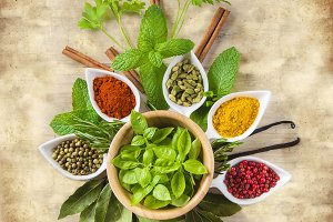 Fresh herbs and spices on a vintage  background