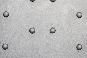 Steel beam with metal rivets.