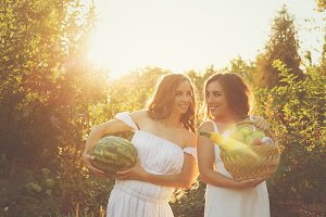 Two sisters are holding harvest