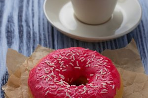 Donut and cup of coffee.