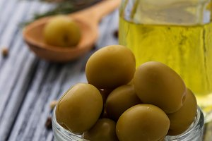 Olives and bottle of olive oil.