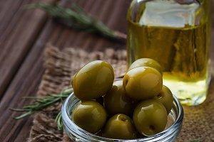 Olives and bottle of olive oil.