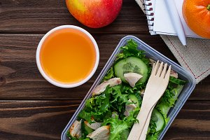 Lunch box with salad and juice
