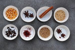 cupcakes trays with spices and seeds