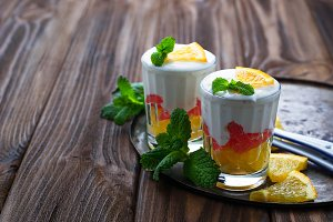 Dessert with cream, orange and mint