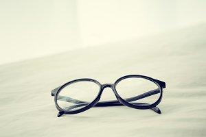 Eyeglasses on messed bed