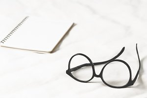 Eyeglass and open book