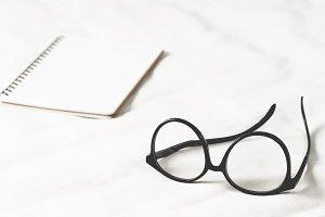 Eyeglass and open book