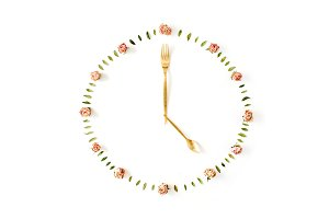 Clock face made of rose buds