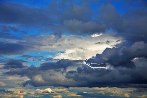 The cloudy dark blue sky