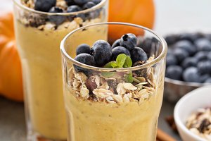 Pumpkin smoothie with granola and berries