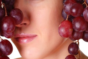 woman with bunch of grape