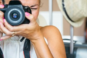 Woman holding digital camera