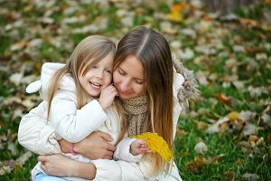 Mother and daughter in autumn park