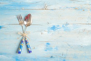 Spoon and fork on blue rustic table