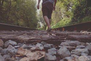 All alone - walking on train tracks