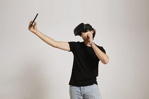 Man in VR glasses taking a selfie