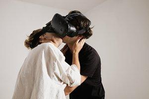 Couple in VR glasses kissing