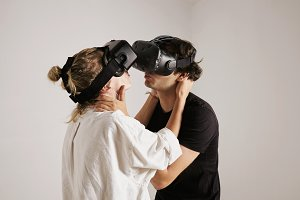 Couple in VR glasses kissing