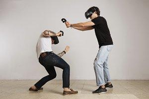 Two men fighting in VR glasses