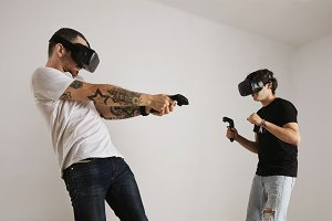 Two men fighting in VR glasses