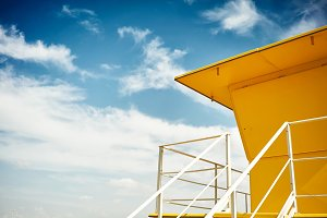Yellow lifeguard post on an empty beach