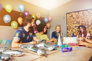 Four friends celebrating for a birthday party