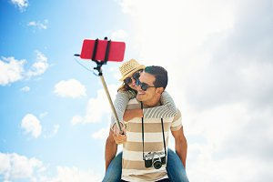 Fun couple taking a selfie piggy backing