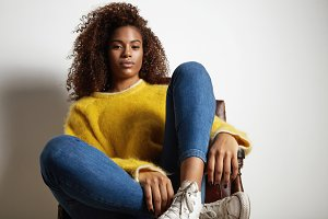 black woman wears yellow sweater