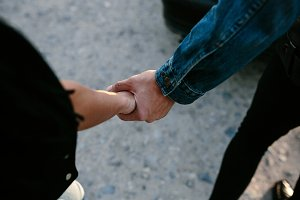 female and male hands together