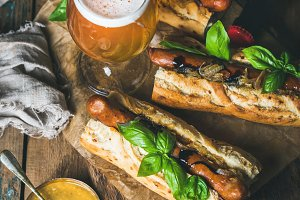 Glass of beer & grilled sausage dogs