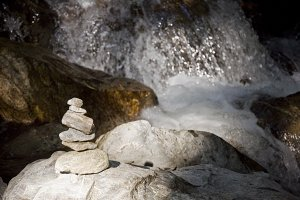 Stacked Rocks and Waterfall