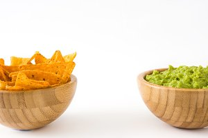 Nachos and guacamole in bowls