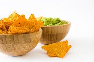 Nachos and guacamole in bowls