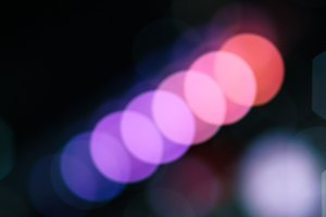 Moving diagonally colourful bokeh for background