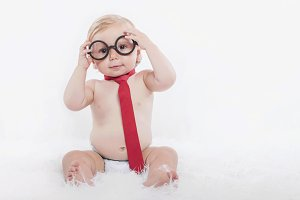 baby with glasses and tie